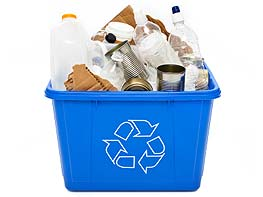 Bin full of recyclables like plastic bottles, tin cans, cardboard, paper