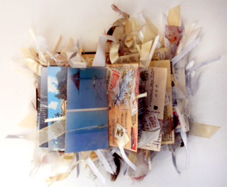 Image of mixed media book with postcards
