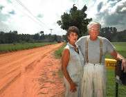 Rural couple at mailbox on dirt road