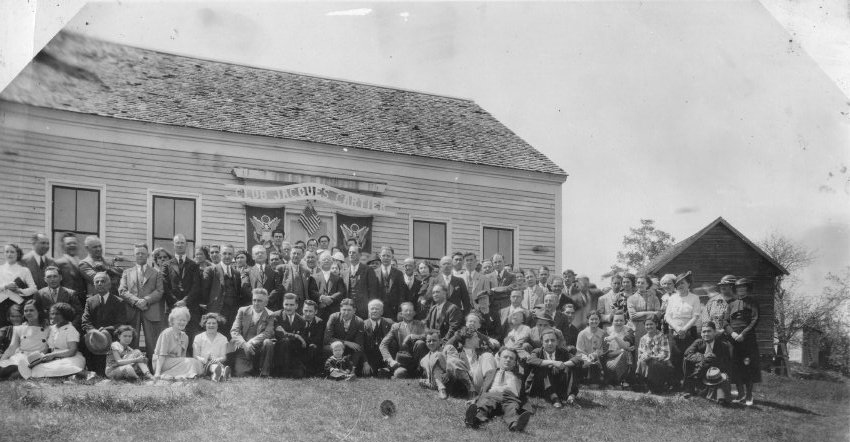 Members of Club Jacques Cartier outside of their clubhouse