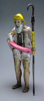 Sculpture of fisherman ready for the beach