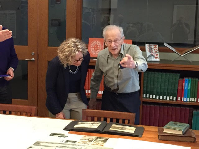 Provost Uzzi and an irrepressible Dr. Osher examining a 1909 photo album of Kineo House.