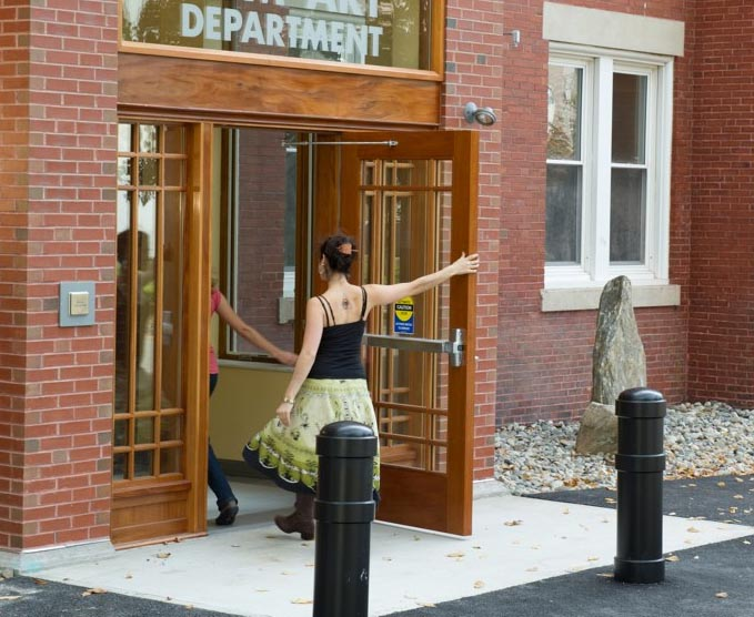Image of students opening door to art building