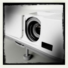 Black and white image of a data projector.