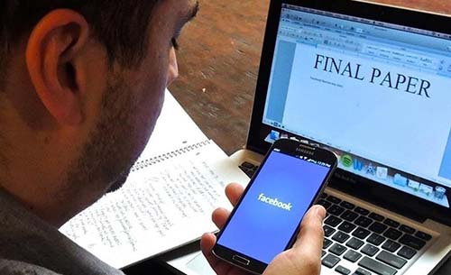 A student checking Facebook instead of writing a final paper.