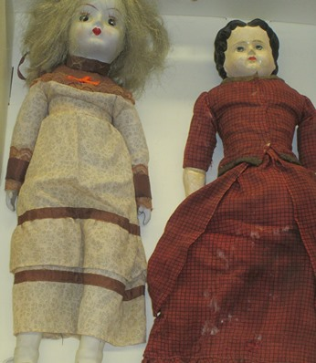 Cloth Dolls with china heads, arms, and legs found in the Alumni House