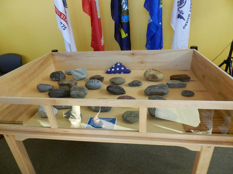 Photo of stones used in Summit Project march in memorial display case