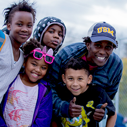 Kusow Aden and kids from Tree Street Youth