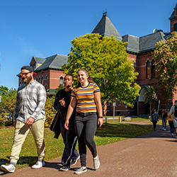 Three students walking together on the USM Gorham campus.