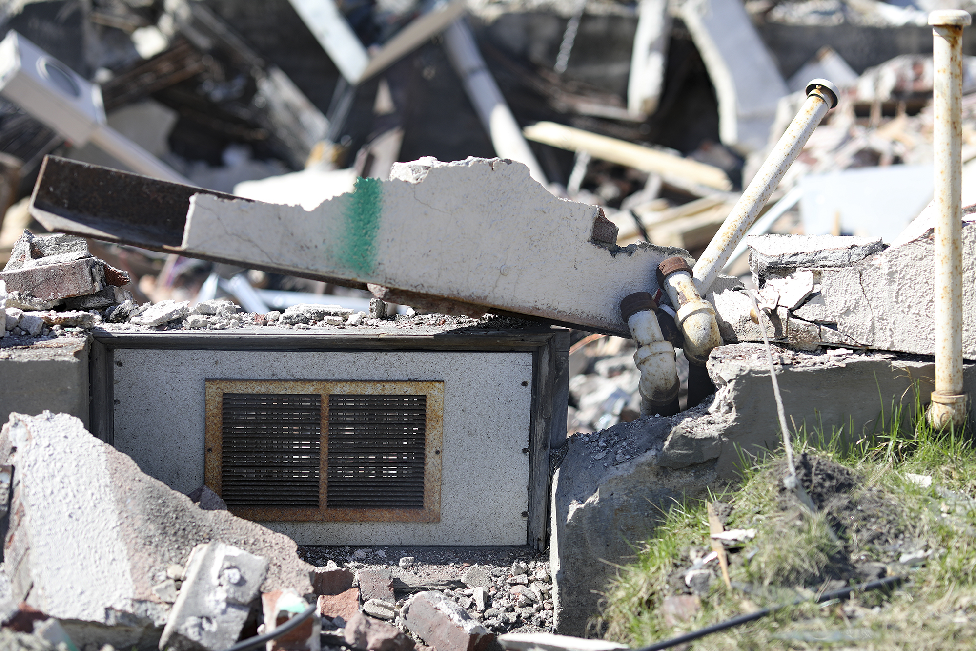 A photo of a window frame that remains intact despite the demolition effort.