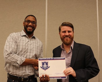 Student Omar Andrews with Jared Lyon, president & CEO of Student Veterans of America