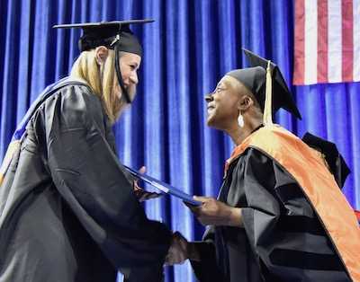 Dean Joyce Gibson with a graduating student