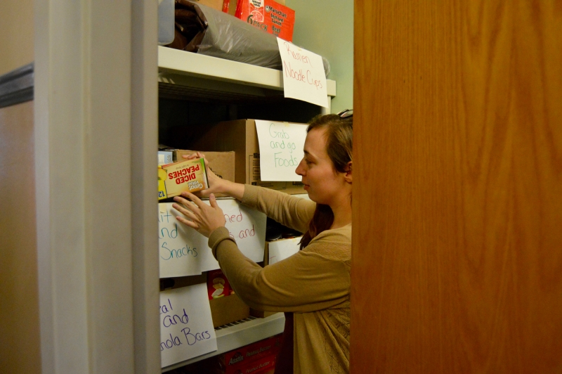 Azia Gilbert stocks up the Husky Hunger Initiative supply closet