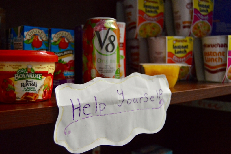 The New Husky Hunger Initiative Help Yourself sign located on the pantry
