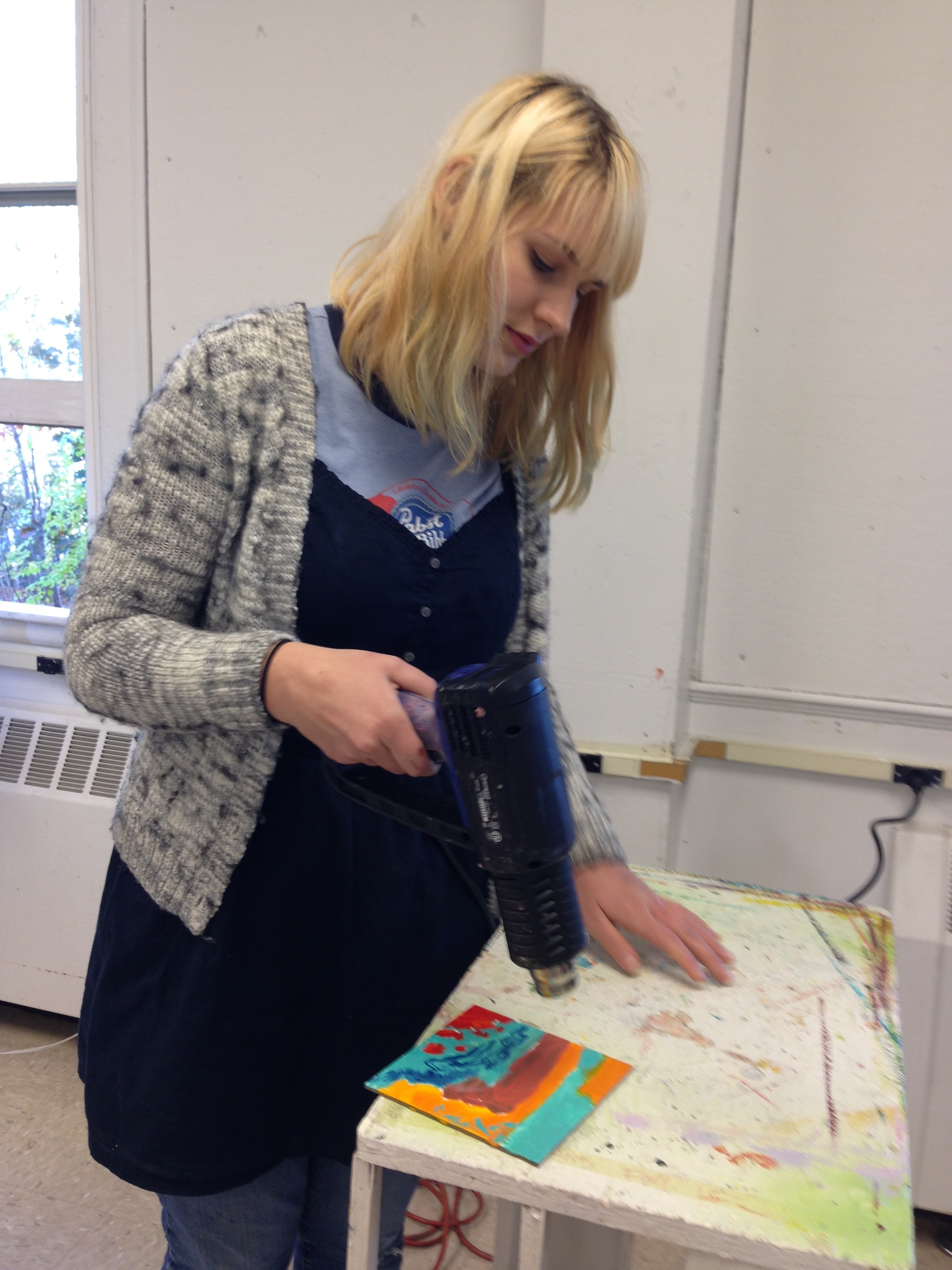 Student working on encaustic project