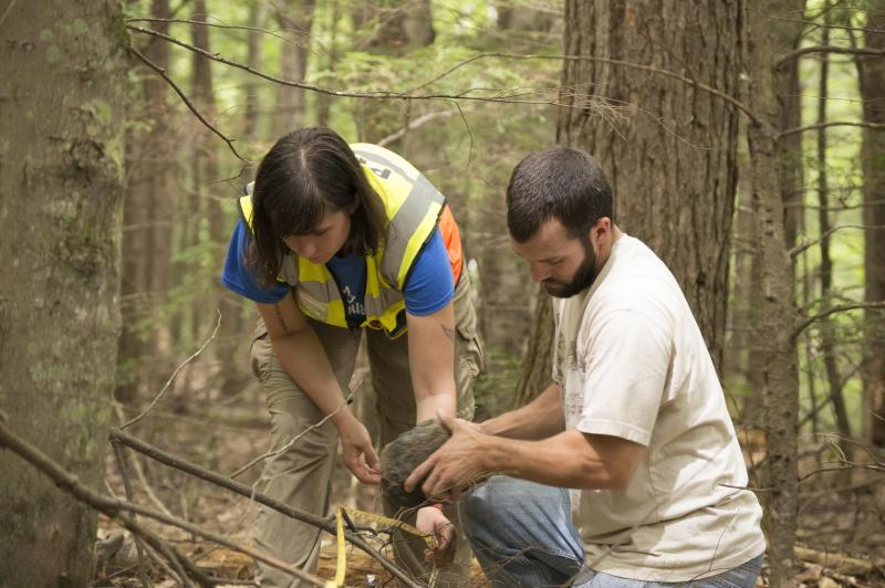 Photo of USM Students Chelsea Malacara (pictured left) and Jaren Wiley (pictured right) working on the Smart Forest on University of Southern Maine's Gorham Campus