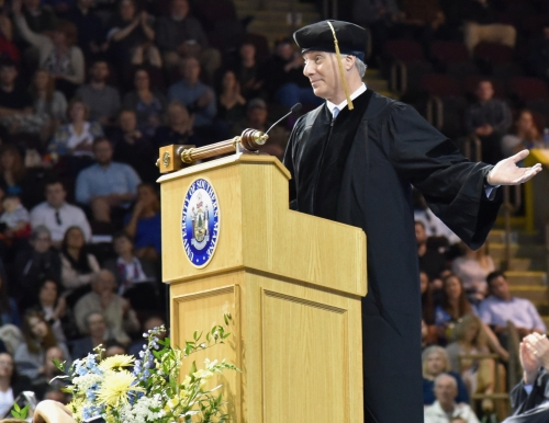 Photo of David Brancaccio deliving the 2017 USM Commencement Address