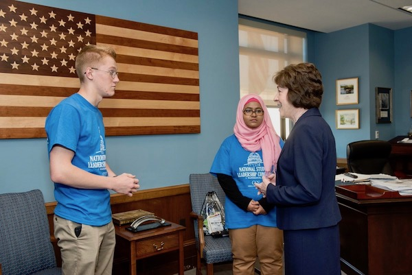 Sen. Susan Collins with students Washima Fairoz and Andrew Cotton