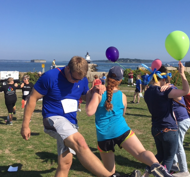 Two ROCC Peers participate in pre-walk exercises at the NAMI Walk 2017