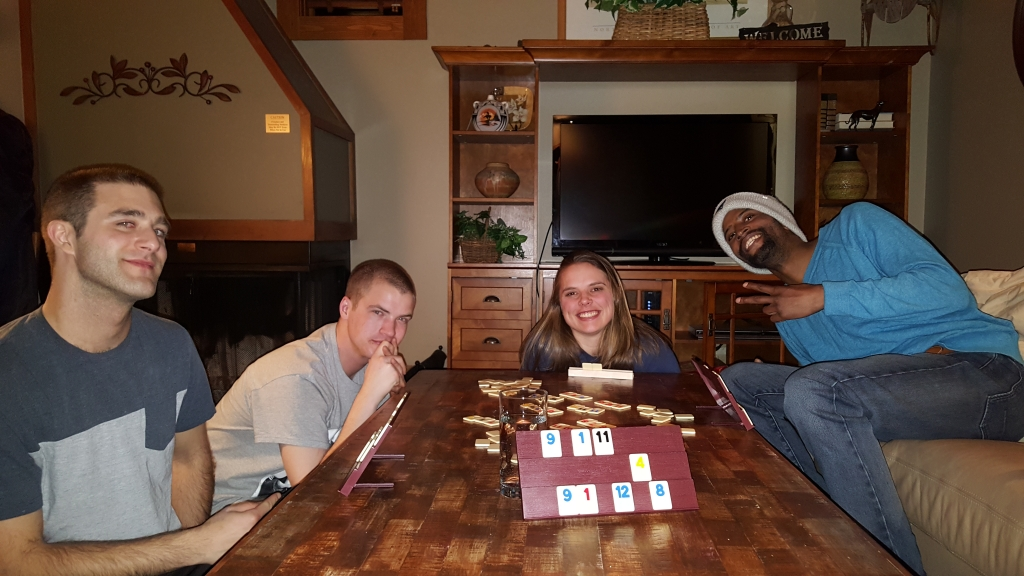Four students playing a board game