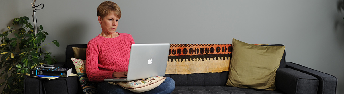 Woman completing coursework on her laptop.