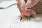 close-up image of student filling out an application