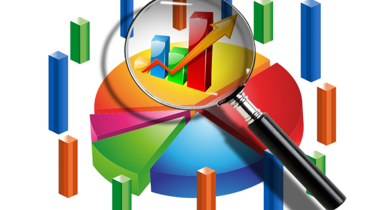 Abstract image of charts, graphs and a magnifying glass