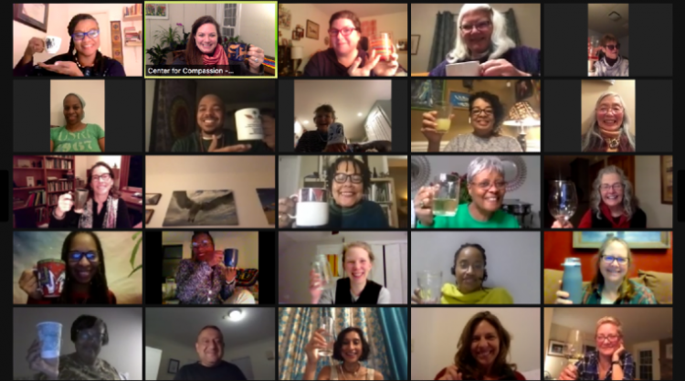 Image of 25 people on a Zoom call; each person is in their own little square, and all are holding up mugs of tea and smiling