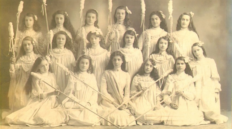 Girls from Sts. Peter and Paul School in Lewiston are dressed for a play called the Shepherdess Drill in 1903.For more information:  https://www.mainememory.net/artifact/18172