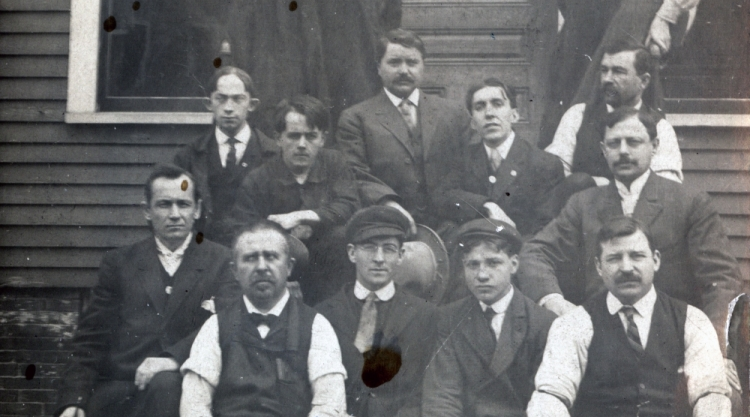 Staff of Le Messager, outside their first Lincoln St Office, Lewiston, 1908. For more information: https://www.mainememory.net/artifact/79912