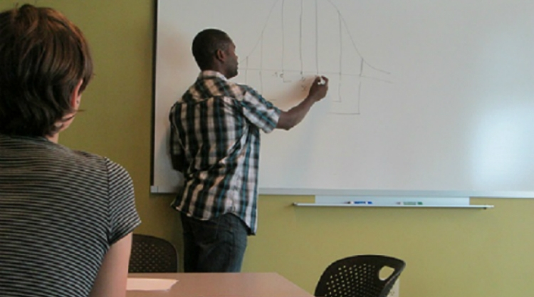 Picture of a tutor assisting a student