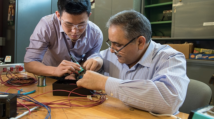 An engineering student and professor working together