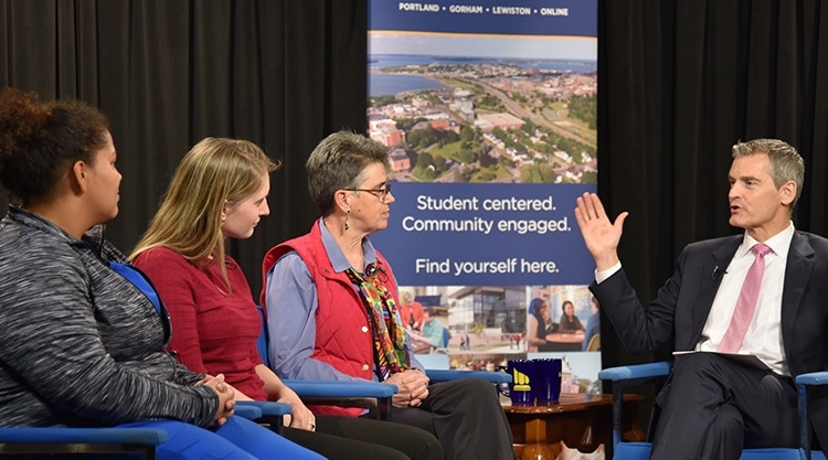 Student Gael Culver, lecturer Ashley Korenkiewicz, assistant professor Patricia Thompson-Leavitt, and President Glenn Cummings on the set of 'The USM Update'