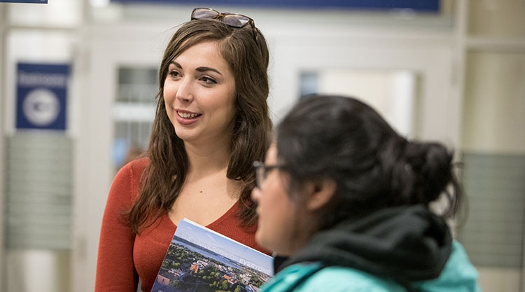 Students asking questions about University programs.