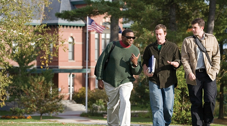 Graduate students walking on campus