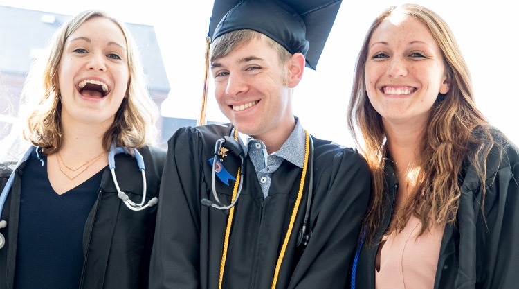 Three students at Commencement