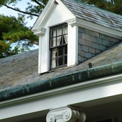An upstairs window of the Stone House.