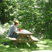 A student in the gardens outside the Stone House.