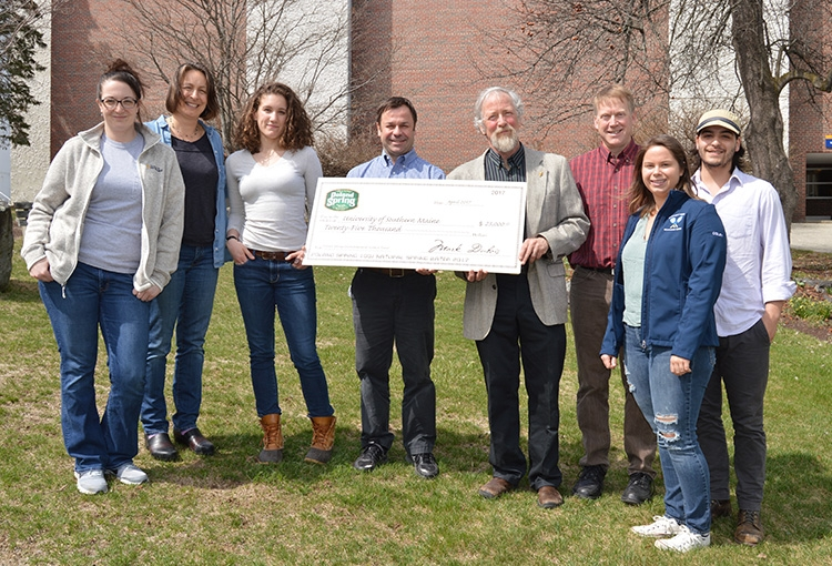 Photo of USM Environmental Science and Policy students and faculty along with Poland Spring representatives