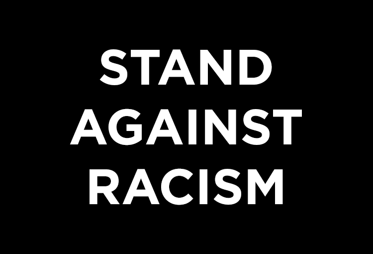A black rectangle featuring white type that reads, Stand Against Racism