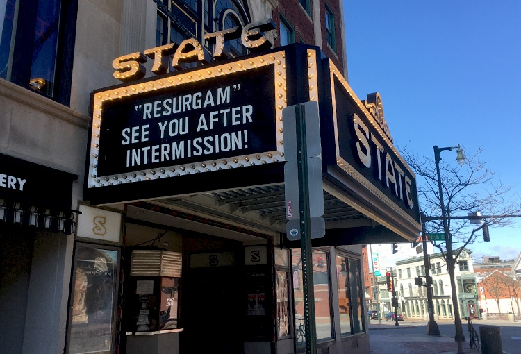 The marquee on the State Theater building in Portland, which reads, Resurgam | See you after intermission!