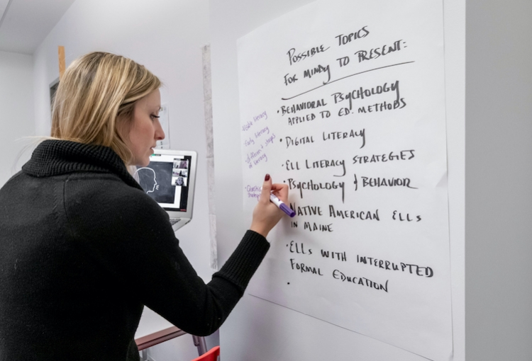 Mindy Butler writing on a whiteboard