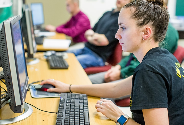 A USM student in a computer lab