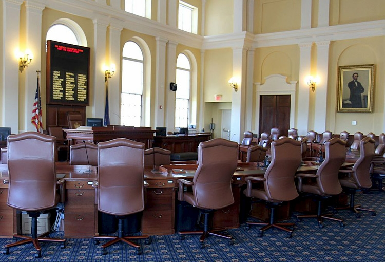 A view from the back of the empty Senate Chamber in the Maine State House in Augusta.