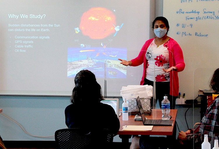 Ashanthi Maxworth, assistant professor of electrical engineering, giving a presentation about space environments for CubeSats.