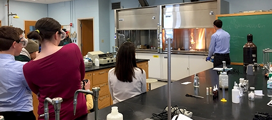 USM Chemistry professor Peter Woodruff does lab demo for Portland H.S. students