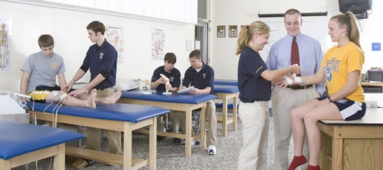 faculty and students in athletic training lab