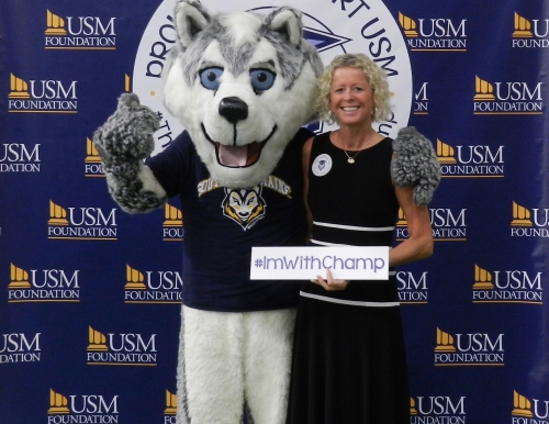 Dean of CMHS, Jo Williams, with Champ.