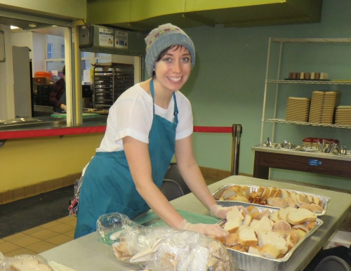 Student prepping food for the event