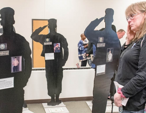Three silhouettes of Maine veterans from the Silhouette Project